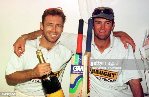 New Zealand's Danny Morrison left and Nathan Astle celebrate their tenth wicket stand to draw the First Test with England at Eden Park Auckland...