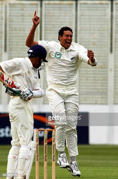 New Zealand's Daryl Tuffey celebrates the wicket of India's Sanjay Bangar caught Scott Styris for 1 on the first day of the first test at the Basin...