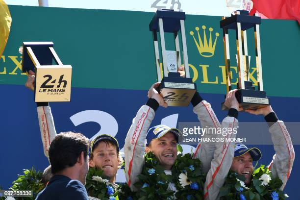 New Zealand's driver Brendon Hartley New Zealand's driver Earl Bamber and Germany's driver Timo Bernhard celebrate with their trophies on the podium...