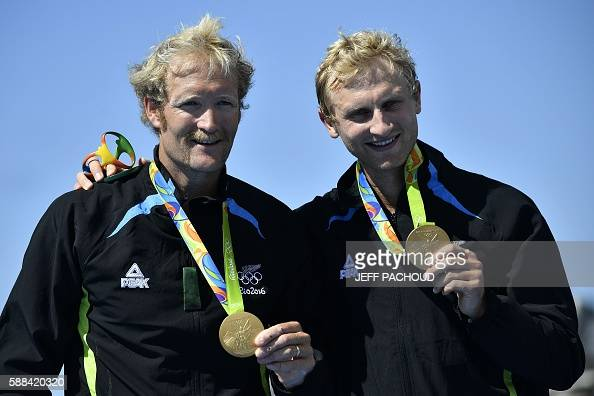 New Zealand's Eric Murray and New Zealand's Hamish Bond celebrate with their gold medals on the podium of Men's Pair final rowing competition at the...