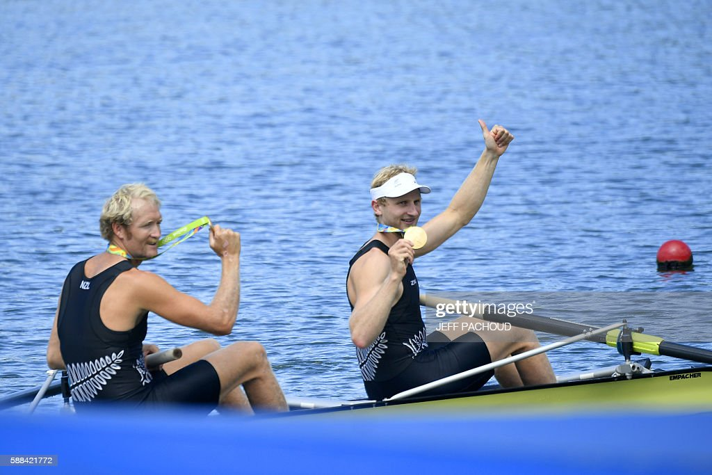 New Zealand's Eric Murray and New Zealand's Hamish Bond celebrate with their gold medals after the podium of Men's Pair final rowing competition at...