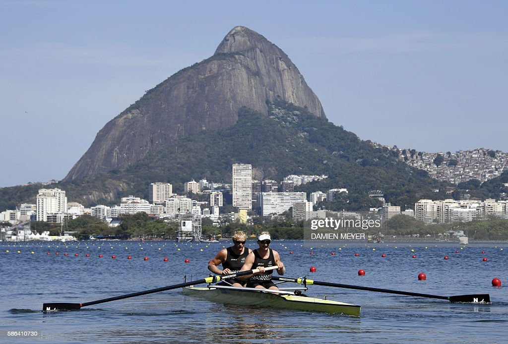 TOPSHOT New Zealand's Eric Murray and New Zealand's Hamish Bond row during the Men's Pair rowing competition at the Lagoa stadium during the Rio 2016...