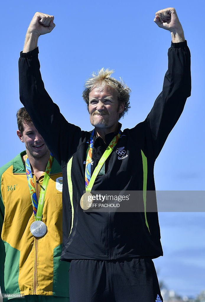 New Zealand's Eric Murray celebrates with his gold medal on the podium of Men's Pair final rowing competition at the Lagoa stadium during the Rio...