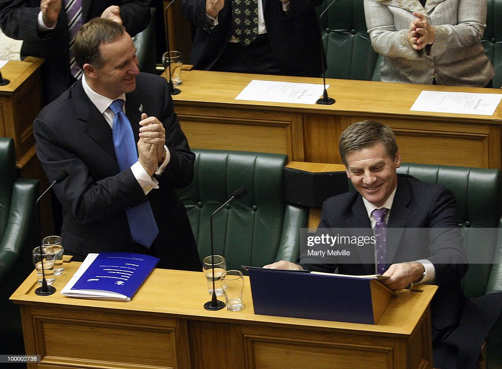 New Zealand's Finance Minister Bill English is congratulated by the Prime Minister of New Zealand John Key after the reading the Budget in Parliament House on May 20, 2010 in Wellington, New Zealand. English announced tax cuts across the board, with all income tax rates to be cut from October this year and company tax rates from April next year.