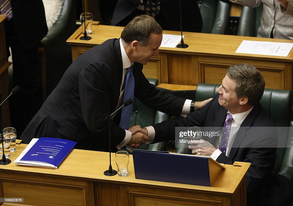 New Zealand's Finance Minister Bill English is congratulated by the Prime Minister of New Zealand John Key after the reading the Budget in Parliament...