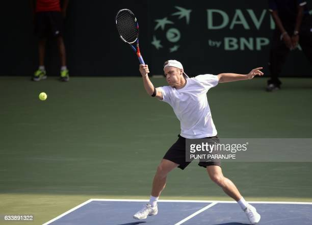 New Zealand's Finn Tearney returns a shot during a Davis Cup singles tennis match against India's Ramkumar Ramanathan at the Balewadi Sports Complex...