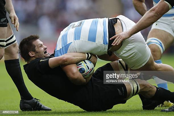 New Zealand's flanker and captain Richie McCaw tackles Argentina's hooker and captain Agustin Creevy during a Pool C match of the 2015 Rugby World...