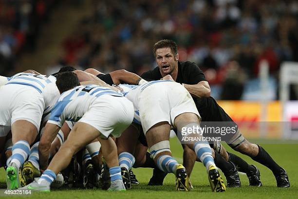 New Zealand's flanker and captain Richie McCaw vies in a scrum during a Pool C match of the 2015 Rugby World Cup between New Zealand and Argentina at...