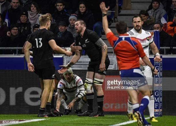 New Zealand's flanker Liam Squire is congratulated by his teammate New Zealand's centre Jack Goodhue after scoring a try during the international...
