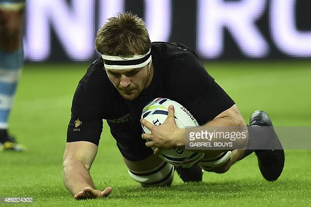 New Zealand's flanker Sam Cane scores a try during a Pool C match of the 2015 Rugby World Cup between New Zealand and Argentina at Wembley stadium...