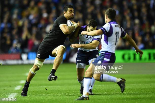 New Zealand's flanker Vaea Fifita is tackled by Scotland's wing Lee Jones during the international rugby union test match between Scotland and New...