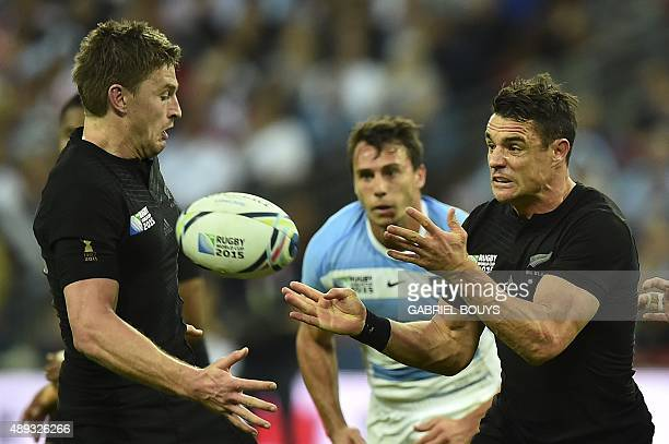 New Zealand's fly half Dan Carter passes the ball next to New Zealand's fly half Beauden Barrett during a Pool C match of the 2015 Rugby World Cup...