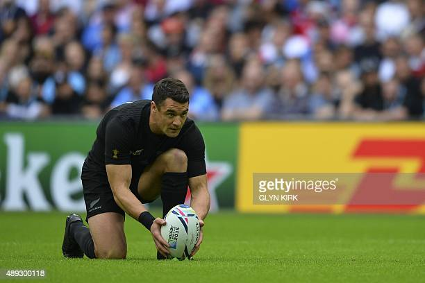 New Zealand's fly half Dan Carter places the ball prior to kicking a penalty during a Pool C match of the 2015 Rugby World Cup between New Zealand...