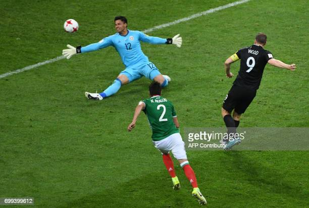 New Zealand's forward Chris Wood kicks to score a goal past Mexico's goalkeeper Alfredo Talavera during the 2017 Confederations Cup group A football...