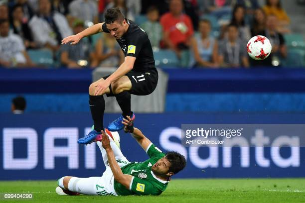New Zealand's forward Marco Rojas vies with Mexico's defender Nestor Araujo during the 2017 Confederations Cup group A football match between Mexico...