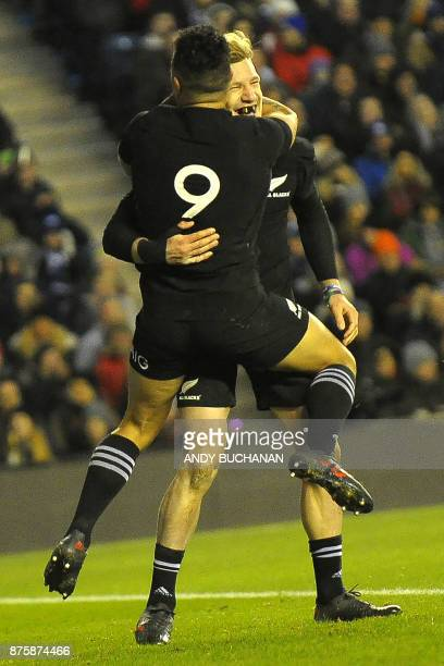 New Zealand's fullback Damian McKenzie celebrates scoring New Zealand's second try during the international rugby union test match between Scotland...