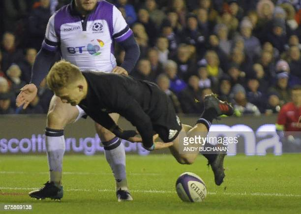 New Zealand's fullback Damian McKenzie scores New Zealand's second try during the international rugby union test match between Scotland and New...