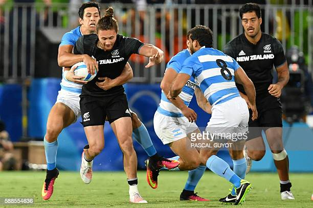 New Zealand's Gillies Kaka is tackled in the mens rugby sevens match between New Zealand and Argentina during the Rio 2016 Olympic Games at Deodoro...