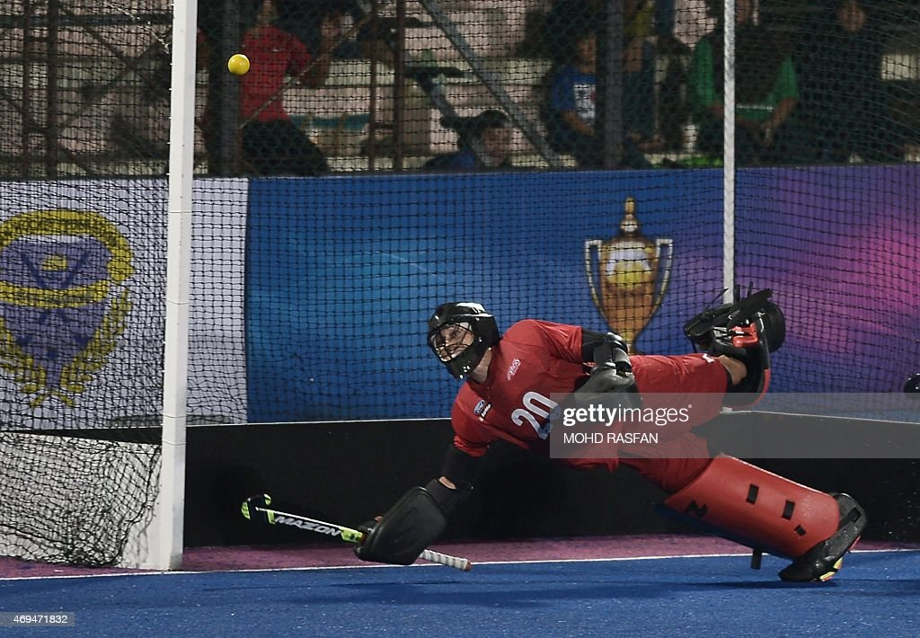 New Zealand's goalkeeper Devon Manchester dives to save the ball during the Sultan Azlan Shah Cup men's field hockey tournament finals against...