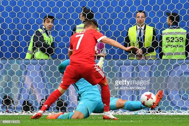 New Zealand's goalkeeper Stefan Marinovic blocks the ball from Russia's forward Dmitry Poloz during the 2017 Confederations Cup group A football...