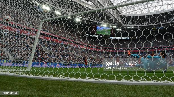 New Zealand's goalkeeper Stefan Marinovic fails to save a penalty kicked by Portugal's forward Cristiano Ronaldo during the 2017 Confederations Cup...