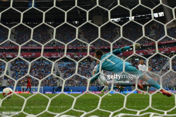 New Zealand's goalkeeper Stefan Marinovic fails to save the ball kicked by Portugal's forward Nani to score the team's fourth goal during the 2017...