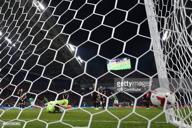 TOPSHOT New Zealand's goalkeeper Stefan Marinovic fails to stop the ball during the 2017 Confederations Cup group A football match between Mexico and...