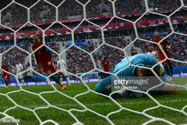 New Zealand's goalkeeper Stefan Marinovic reacts after failing to save a penalty kicked by Portugal's forward Cristiano Ronaldo during the 2017...
