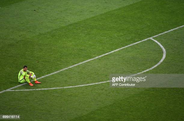 TOPSHOT New Zealand's goalkeeper Stefan Marinovic sits on the pitch during the 2017 Confederations Cup group A football match between Mexico and New...