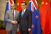 New Zealand's Governor General Jerry Mateparae shakes hands with Chinese Premier Li Keqiang as he arrives for a bilateral meeting at the Great Hall...