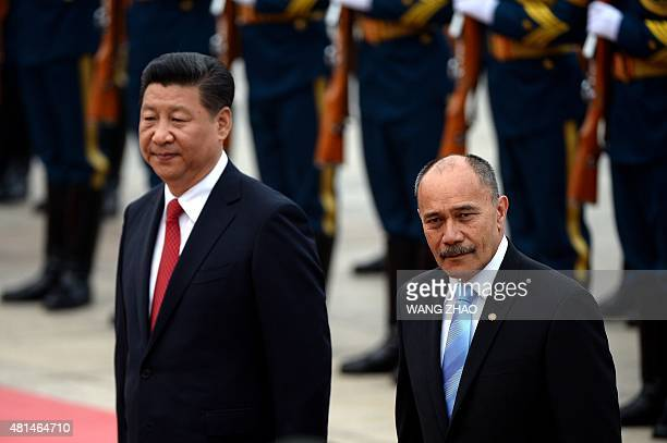 New Zealand's GovernorGeneral Jerry Mateparae and Chinese President Xi Jinping inspect Chinese honour guards during a welcome ceremony outside the...