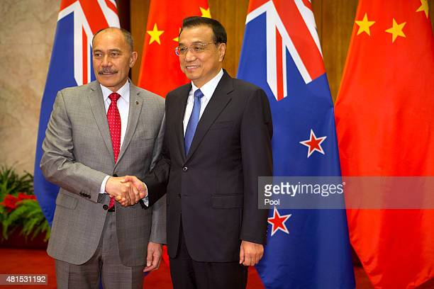 New Zealand's GovernorGeneral Sir Jerry Mateparae left shakes hands with Chinese Premier Li Keqiang right as he arrives for a bilateral meeting at...