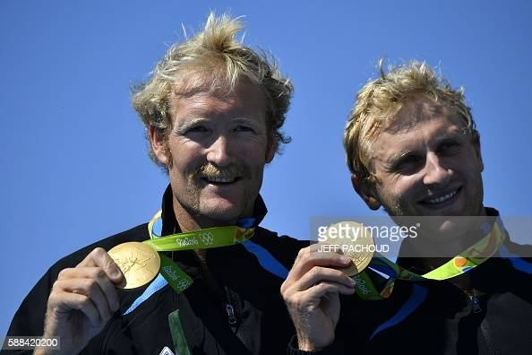 New Zealand's Hamish Bond and New Zealand's Eric Murray celebrate with their gold medals on the podium of Men's Pair final rowing competition at the...