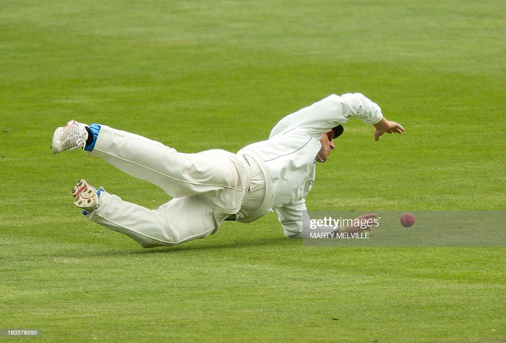 New Zealand's Hamish Rutherford fields the ball during day four of the first international cricket Test match between New Zealand and England played at the University Oval park in Dunedin on March 9, 2013. AFP PHOTO / Marty MELVILLE