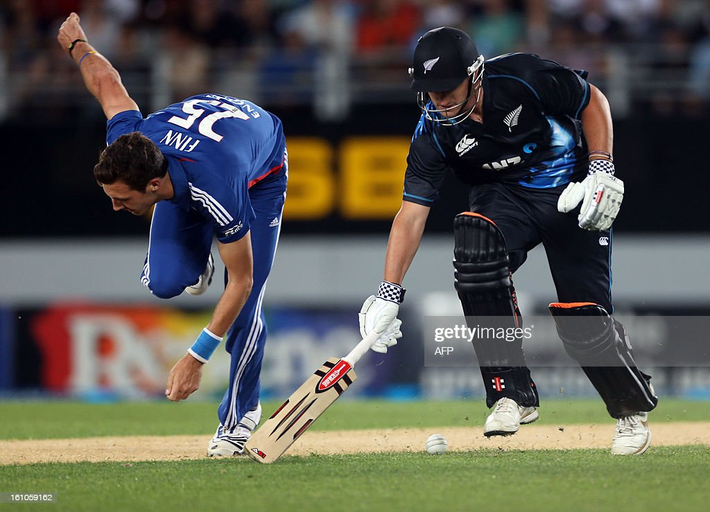 New Zealand's Hamish Rutherford makes his ground as England's Steven Finn looks on during the International Twenty20 cricket match between New Zealand and England played at Eden Park in Auckland on Febuary 9, 2013. AFP PHOTO / Michael BRADLEY