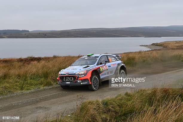 New Zealand's Hayden Paddon and codriver John Kennard drive their Hyundai Mototrsport New Generation i20 WRC during the Brenig stage of the Wales...