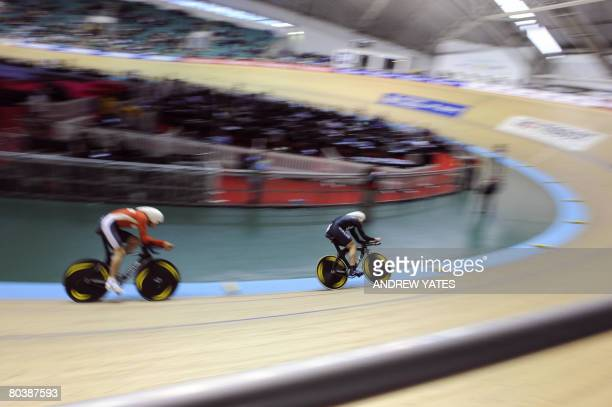New Zealand's Hayden Roulston competes against Germany's Robert Bengsch during the Men's individual pursuit qualifying round in the UCI Track Cycling...