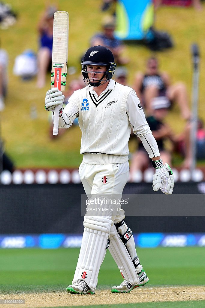 New Zealand's Henry Nicholl celebrates 50 runs during day four of the first cricket Test match between New Zealand and Australia at the Basin Reserve in Wellington on February 15, 2016. / AFP / Marty Melville