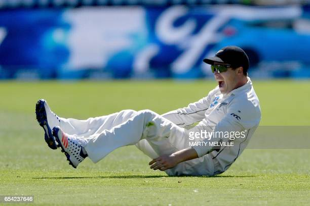 New Zealand's Henry Nicholls celebrates taking the catch of South Africa's Hashim Amla during day two of the second Test cricket match between New...