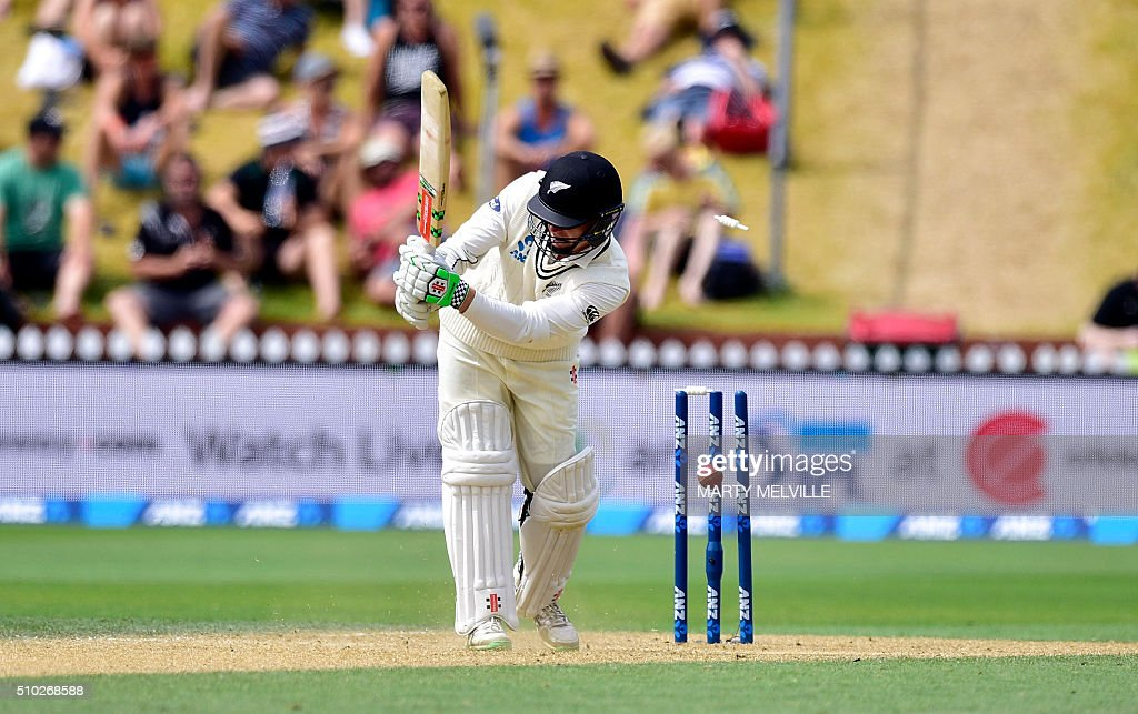 New Zealand's Henry Nicholls is bowled during day four of the first cricket Test match between New Zealand and Australia at the Basin Reserve in Wellington on February 15, 2016. / AFP / Marty Melville