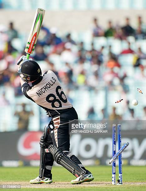 New Zealand's Henry Nicholls is bowled during the World T20 cricket tournament match between Bangladesh and New Zealand at The Eden Gardens Cricket...