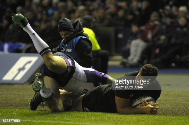 New Zealand's hooker Codie Taylor scores the first try during the international rugby union test match between Scotland and New Zealand at...