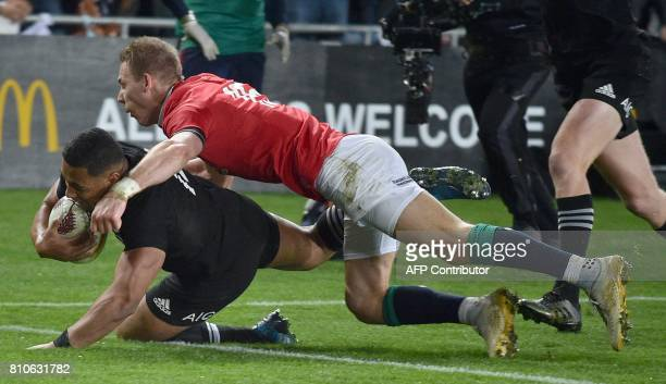 New Zealand's inside centre Ngani Laumape is tackled by British and Irish Lions fullback Liam Williams as he scores the first try during the third...
