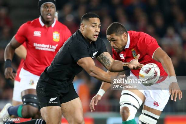 New Zealand's inside centre Ngani Laumape passes the ball during the third rugby union Test match between the British and Irish Lions and New Zealand...