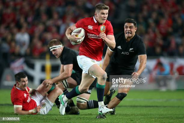 New Zealand's inside centre Ngani Laumape tries to tackle British and Irish Lions inside centre Owen Farrell during the third rugby union Test match...