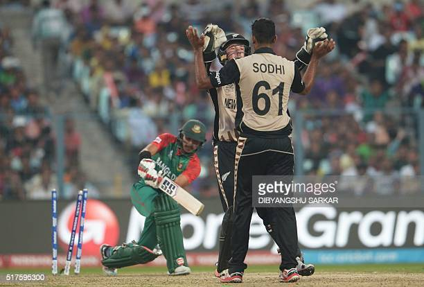 New Zealand's Ish Sodhi celebrates after the dismissal of Bangladesh's Soumya Sarkar during the World T20 cricket tournament match between Bangladesh...