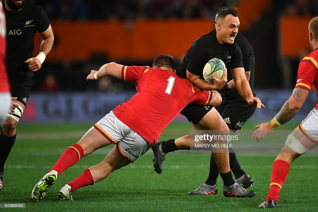 New Zealand's Israel Dagg (R) is tackled by Rob Evans of Wales (centre L) during the third rugby union Test match between the New Zealand All Blacks and Wales at Forsyth Barr Stadium in Dunedin on June 25, 2016. / AFP / Marty Melville