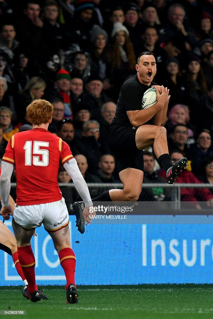 New Zealand's Israel Dagg (R) jumps for the ball as Rhys Patchell of Wales (L) looks on during the third rugby union Test match between the New Zealand All Blacks and Wales at Forsyth Barr Stadium in Dunedin on June 25, 2016. / AFP / Marty Melville