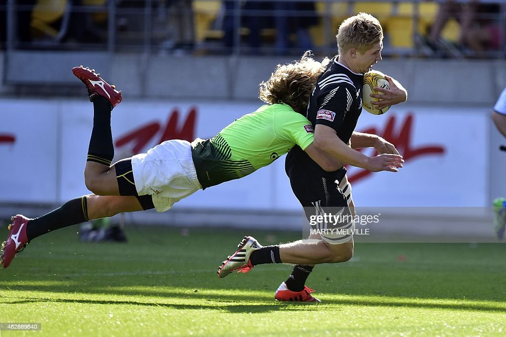 New Zealand's Jack Goodhue runs in a try as he is tackled by South Africa's Werner Kok during their cup semi final on day two of the IRB...