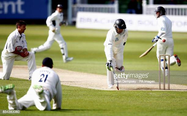 New Zealand's James Marshall runs in safe from a run out attempt thrown Kent's Niel Dexter during the tour match at the St Lawrence Ground Canterbury
